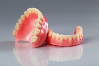Denture is kept on the glossy table
