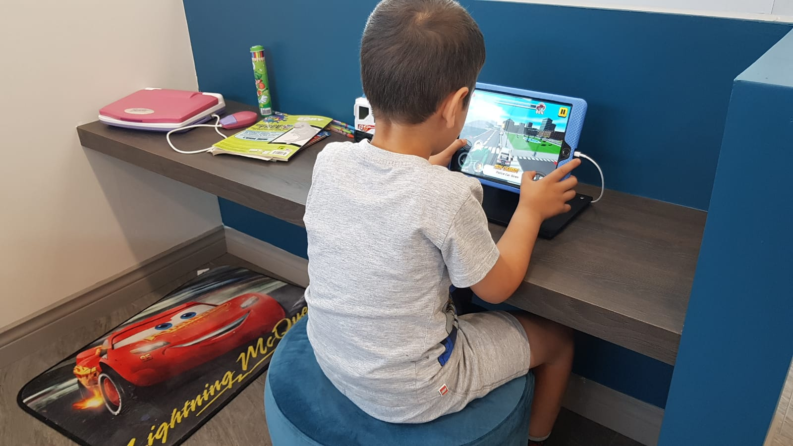 Boy playing video game at waiting area