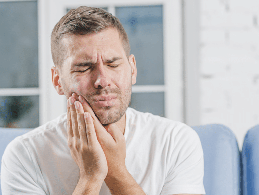 Close up of the man suffering from toothache