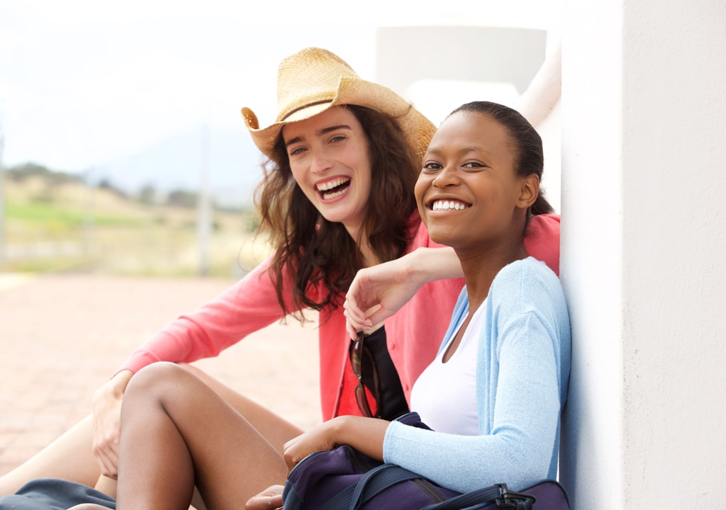 Two girls are laughing